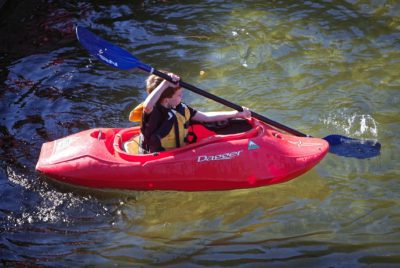 Child Learning How To Do Kayak Strokes