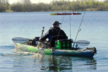 Fisherman With Kayak Fishing Accessories